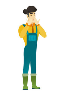 Shoked asian farmer in coveralls covering his mouth with hand. Full length of shoked farmer. Farmer with a shocked facial expression. Vector flat design illustration isolated on white background.