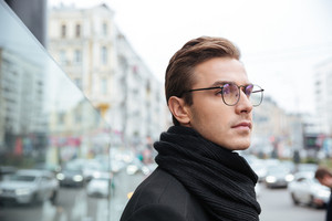 Side view of business man on glasses on the street