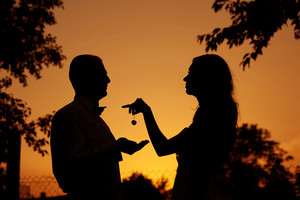 Silhouette of bride and groom enjoying their wedding day in nature during the sunset