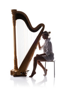 Silhouette of woman playing the harp, isolated on white background