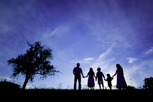 Silhouettes of happy parents having fun with their children