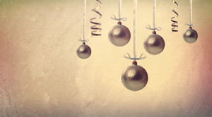 Silver Christmas ornaments hanging in vintage style