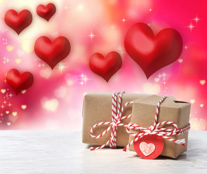 Small handmade gift boxes with red hearts