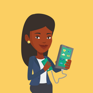 Smiling african-american woman recharging her smartphone with mobile phone portable battery. Young woman holding a mobile phone and battery power bank. Vector flat design illustration. Square layout.