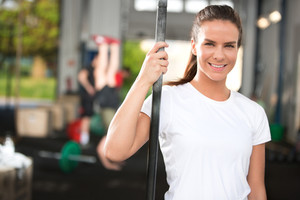 Smiling and attractive woman at fitness center
