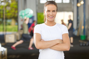Smiling and confident woman at fitness gym