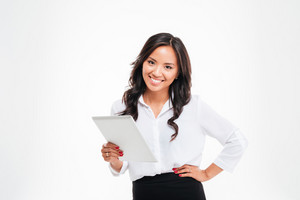 Smiling asian businesswoman standing with tablet computer over white background