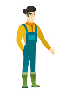 Smiling asian farmer in coveralls with his hand in pocket. Full length of young happy farmer holding his hand in the pocket of pants. Vector flat design illustration isolated on white background.