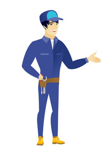 Smiling asian mechanic with his hand in his pocket. Full length of young happy mechanic holding his hand in the pocket of pants. Vector flat design illustration isolated on white background.