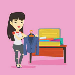Smiling asian woman putting a jacket into a suitcase. Young business woman packing her clothes in an opened suitcase. Woman preparing for vacation. Vector flat design illustration. Square layout.