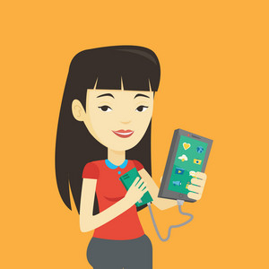 Smiling asian woman recharging her smartphone with mobile phone portable battery. Young woman holding a mobile phone and battery power bank. Vector flat design illustration. Square layout.