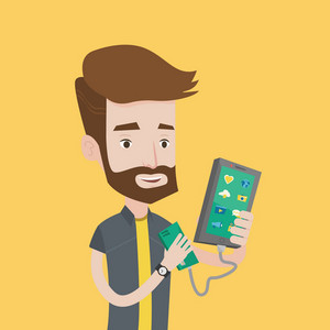 Smiling hipster man with the beard recharging his smartphone with mobile phone portable battery. Young man holding a mobile phone and battery power bank. Vector flat design illustration. Square layout