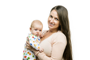 Smiling mother holding a baby in her arms isolated on white background
