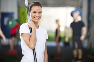 Smiling woman at fitness gym center