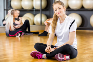 Smiling woman in workout outfit at the fitness gym