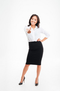 Smiling young asian businesswoman showing thumb up isolated on a white background