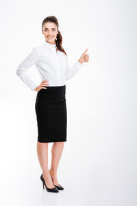 Smiling young businesswoman showing thumb up isolated on a white background
