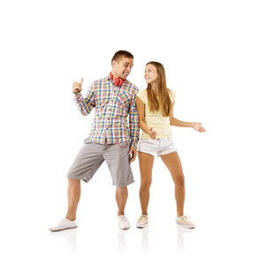 Smiling young people dancing, isolated on white background