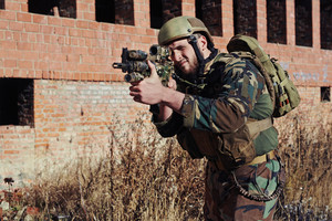 Special army soldier with gun shooting outside