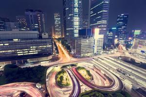 Spinning illuminated traffic loops outside the entrance of Shinjuku Station, Shinjuku, Tokyo, Japan
