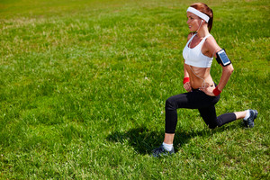 Sporty girl exercising in park