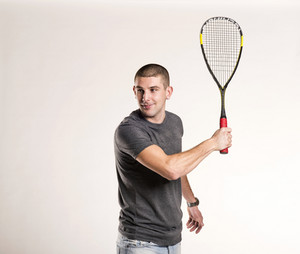 Squash player with racquet isolated on white background