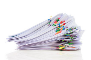 Stack of documents with colorful clips isolated on white background
