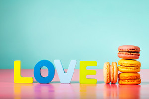 Stack of macarons on with love wood block letters
