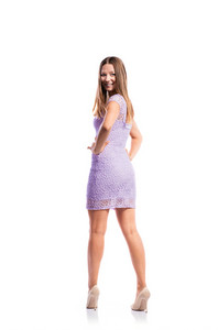Standing teenage girl in elegant purple lace dress, heels, arms on hips, studio shot, young woman, isolated on white background, back view, rear viewpoint