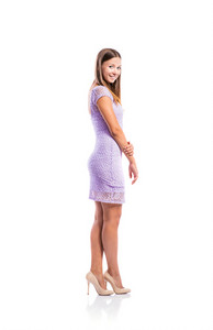 Standing teenage girl in elegant purple lace dress, heels, legs crossed, studio shot, young woman, isolated on white background