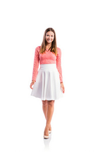 Standing teenage girl in pink lace top and elegant white skirt, heels, studio shot, young woman, isolated on white background