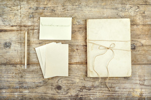 Stationery set on a wooden floor background. View from above.