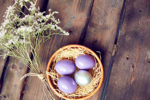 Still life of purple eggs and flowers