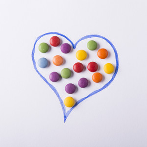 Studio concept with small round colorful candies