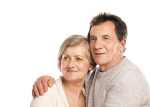 Studio portrait of happy senior couple in love. Isolated over white background.