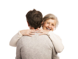 Studio portrait of happy seniors couple hugging. Isolated on white background.
