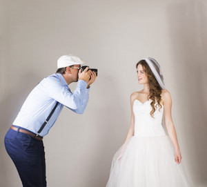 Studio portraits with beautiful bride and photographer