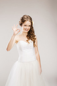 Studio portraits with beautiful bride isolated on gray background