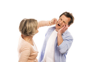 Studio shot of angry senior couple having an argument, isolated on white background. Marriage in crisis.