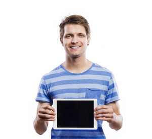 Stylish handsome young man with tablet. Studio shot on white background