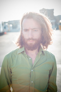 stylish hipster model with long red hair and beard lifestyle in the street