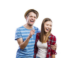 Stylish young hipster couple posing. Studio shot on white background