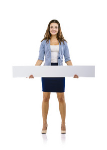 Successful business woman is standing and holding blank banner, isolated background.