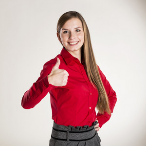 Successful business woman is standing on isolated background.