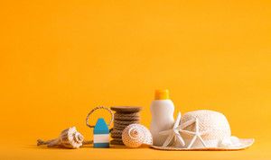 Summer and beach objects theme on a bright yellow background