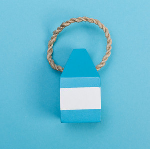 Summer ornament on a blue paper background
