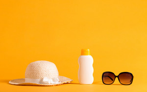 Summer sun protection objects theme on a yellow background