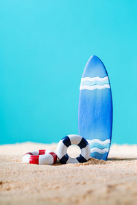 Summer theme with surfboard on a bright blue background