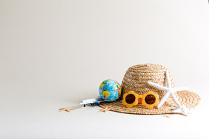 Summer travel theme on an off white background