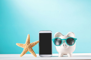 Summer vacation savings theme with piggy bank and starfish